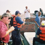 Rick Mathieu and the Soul Patrol feeding FEMA and USFWS responders chicken gumbo at their rooftop camp in the 7th Ward